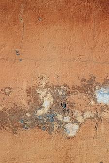 剥離ペイントとコンクリートの石の壁のテクスチャグランジ背景