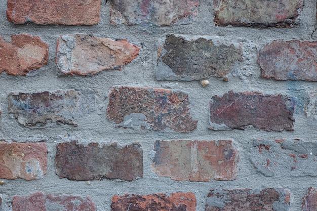 灰色と茶色のレンガの壁の背景