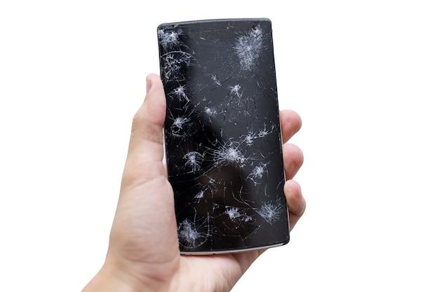 壊れた画面を持つ携帯電話を持っている男の手