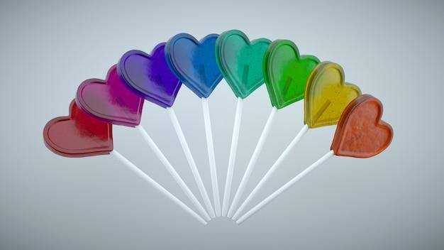 ハートの形をしたカラフルなロリポップ。原色のグラデーション。