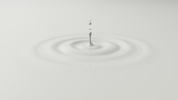 ミルクの表面に落ちるドロップ。白い液体のしぶき。