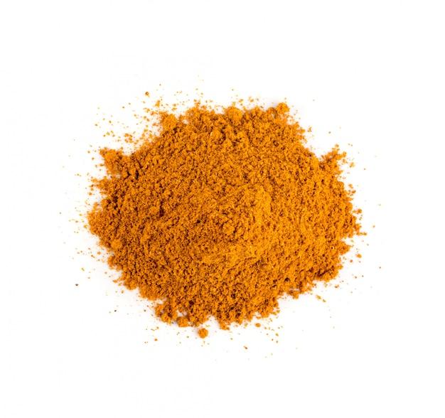 Смесь порошка приправы апельсина, изолированные на белом фоне, вид сверху