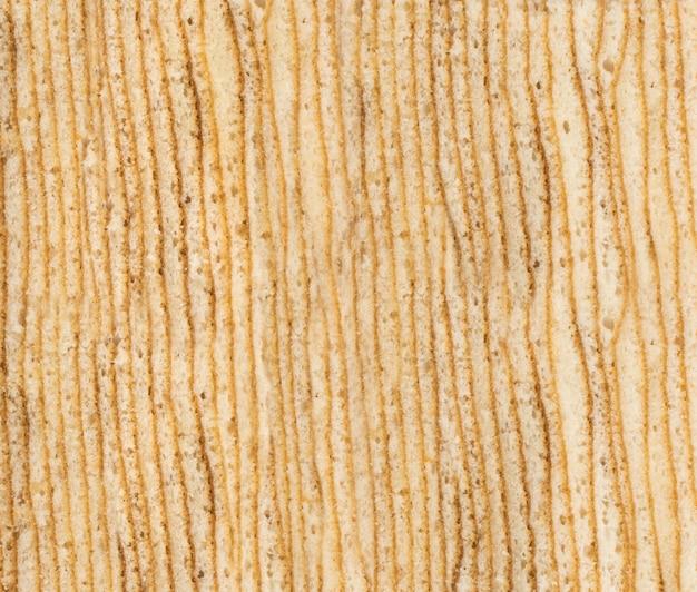 Полосатый бисквитный фон торта. традиционная текстура баумкухена