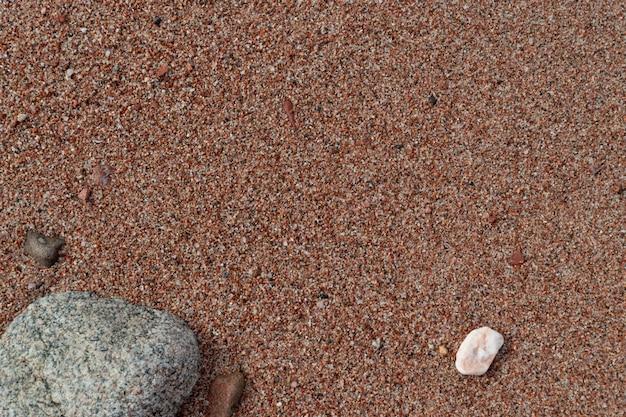 赤い砂と赤い海の石、自然の背景