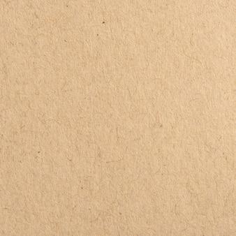 茶色のクラフト紙のテクスチャと背景を閉じます。