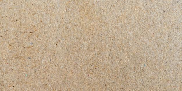 茶色のパノラマ紙表面の質感とコピースペースの背景。