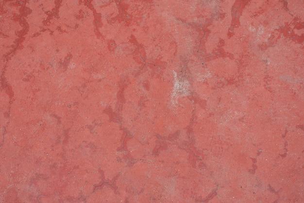 コンクリートの赤い壁の質感とコピースペース