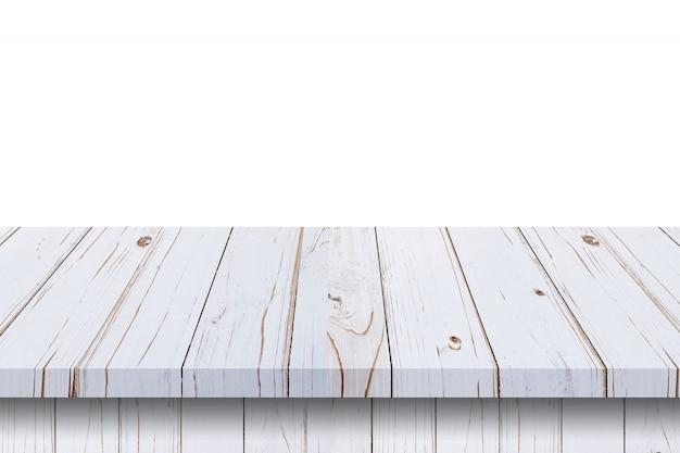 空の白い木製テーブルに白い背景を分離し、製品のコピースペースとモンタージュを表示します。