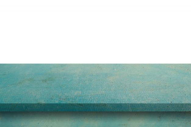 空の青い木製テーブルは、白い背景を分離し、製品のコピースペースとモンタージュを表示します。