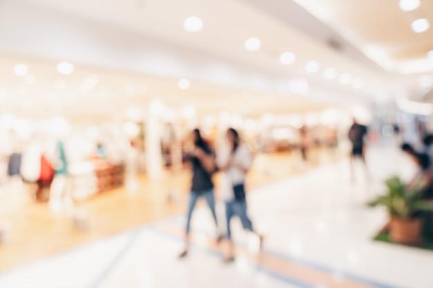 抽象的なぼかし背景群衆、背景のビンテージトーンのショッピングモールの人々。