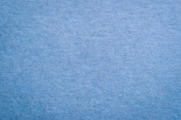 スペースで青い紙の質感と背景を閉じます。