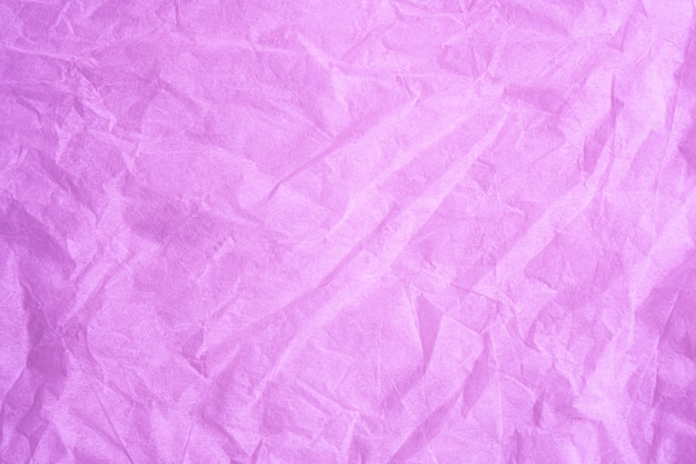 ピンク色のしわ紙ティッシュバックグラウンドテクスチャ。