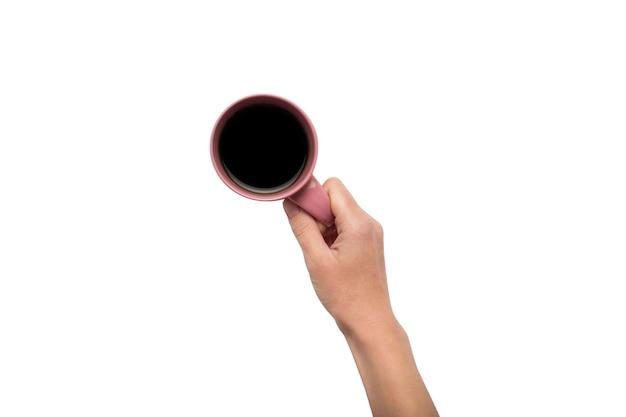 手は、孤立した白地にホットコーヒーとカップを持っています。コーヒーまたは紅茶の朝食のコンセプトです。おはよう、夜、不眠症。フラット横たわっていた、トップビュー