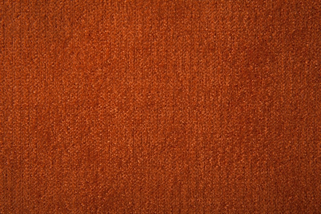 Текстура ткани оранжевого ковролина для фона