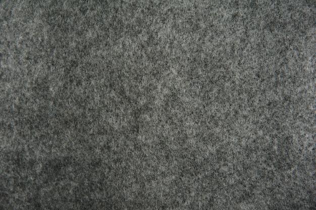 背景の灰色のフェルトテクスチャ