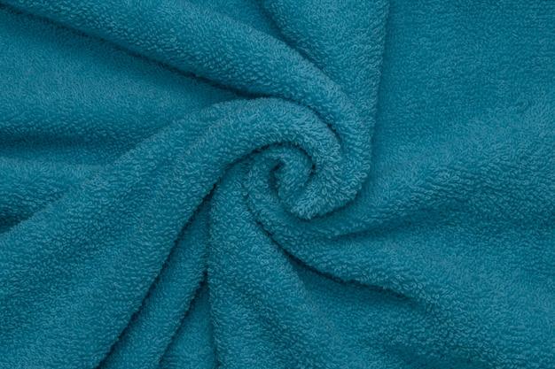 表面の青いタオルのテクスチャ背景