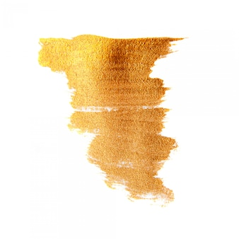 黄金の塗装ブラシテクスチャ背景。分離された輝くゴールドアクリル染色
