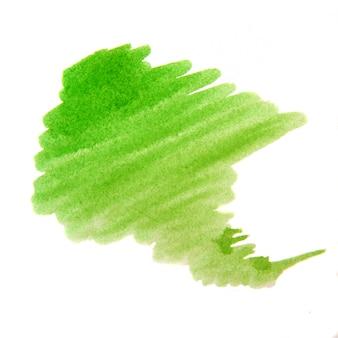 白で隔離される水彩の緑のスポットの表面。