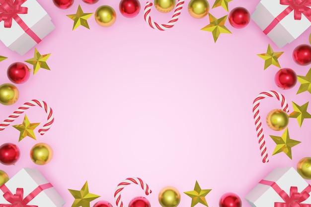 グリーティングカードのピンクの背景にクリスマスの装飾で作られたフレーム。上面図
