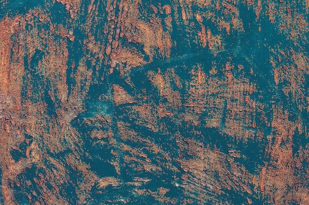 古い青い金属表面。搾取の痕跡が残る錆びた金属の背景。