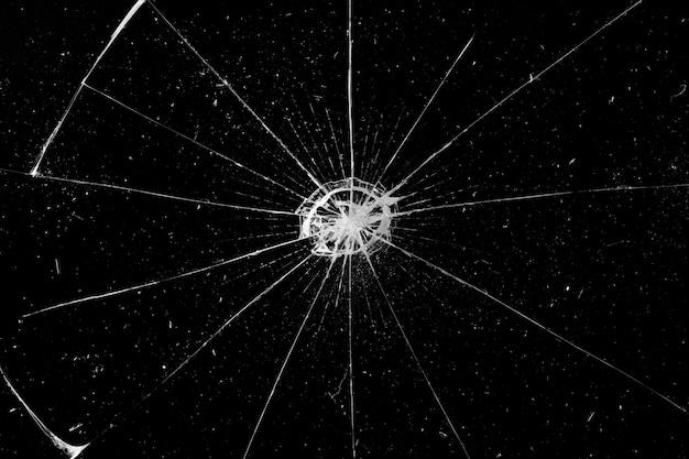 黒の背景に壊れたガラスの質感を抽象化します。ひびの入った黒いガラス