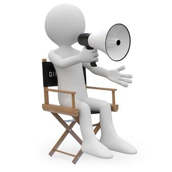 Кинорежиссер сидит в кресле с мегафоном