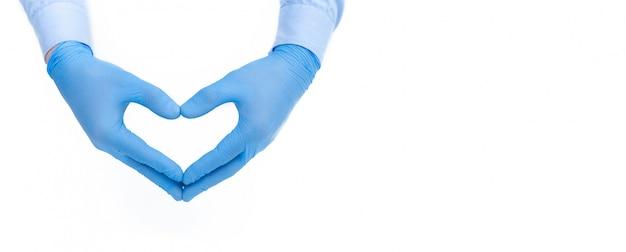医療用手袋をはめた手が心を癒します。薬の概念とコロナウイルスの制御。バナー