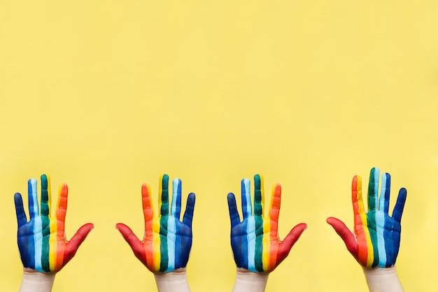 虹色の旗として描かれた手