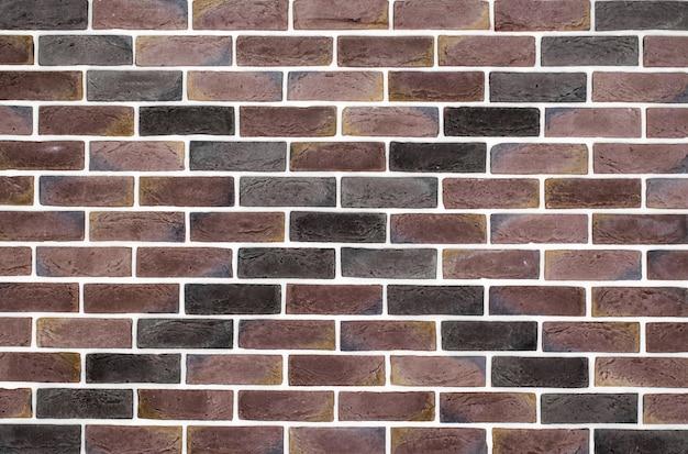 パターンと薄茶色のレンガの壁