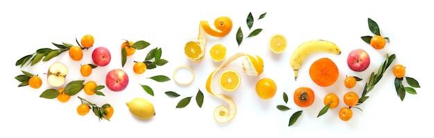 白で隔離される様々な果物からのバナー