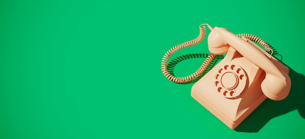 Старинный роторный телефон на зеленом фоне