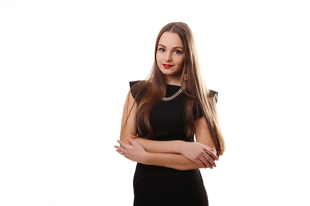 笑顔の黒いドレスの魅力的な若い女性
