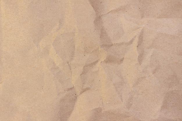 クラフト紙。ベージュのしわくちゃクラフト紙テクスチャ背景