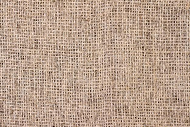 Легкая натуральная льняная текстура для фона. натуральный хлопок, бежевого цвета.