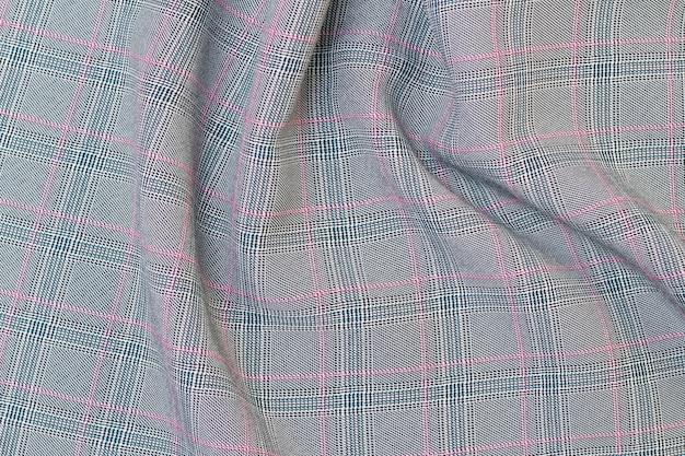 Серая клетка изготовлена из костюмной ткани. костюм ткань фоновой текстуры. костюм крупным планом.