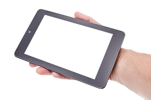 手に近代的なタブレット。テキストのフレーム。