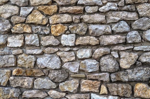 石積みの壁の背景の天然石