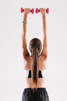 Вид сзади портрет здоровой стройной спортсменки
