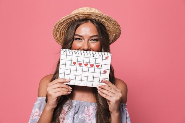 期間カレンダーを保持している麦わら帽子を身に着けている美しい女性の肖像画