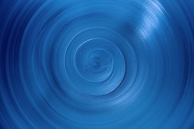 トレンディなファントムブルー色、コピースペースと無限の抽象的な背景のクローズアップビュースパイラルライン