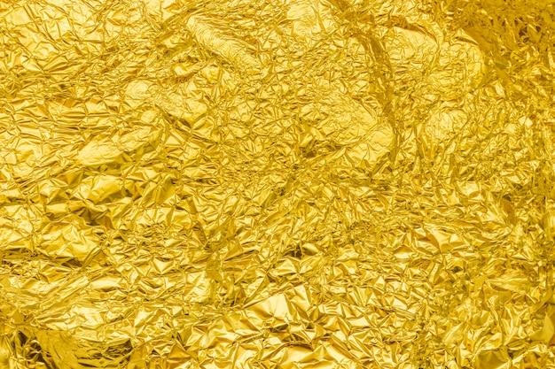 黄金のアルミ箔の背景、トップビュー