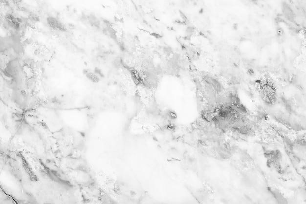 インテリアとエクステリアの美しい自然なパターンのグレーと白の大理石のタイルの背景を持つ白い大理石の表面の背景。