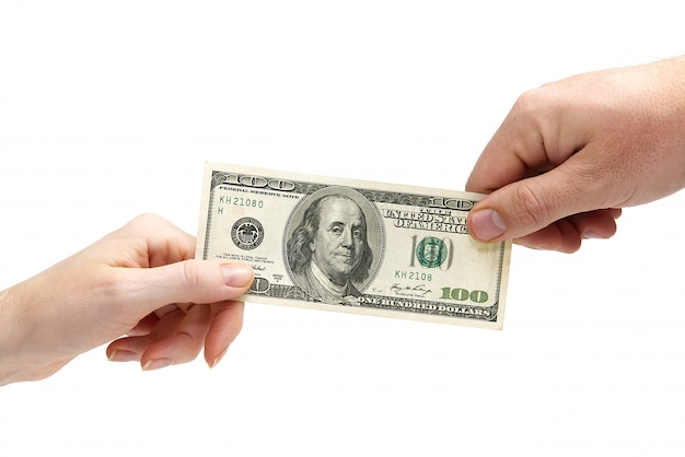 ドル通貨を持っている富の人間の手を金融します。白で隔離