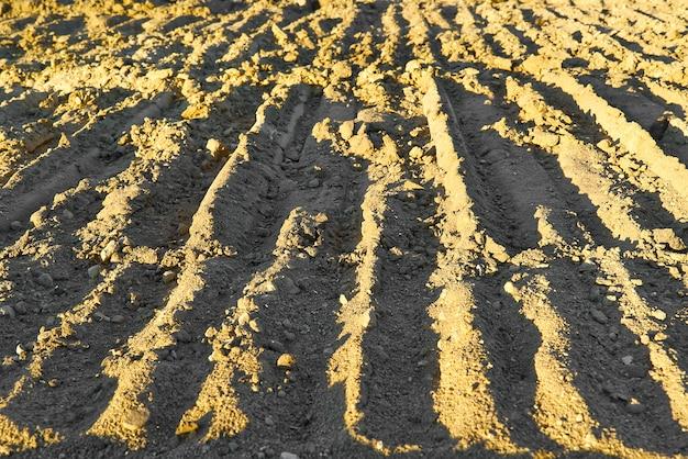 Экскаватор следы на земле текстуры.