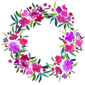 水彩のピンクと紫の花と丸いフローラルリースの緑の青い葉