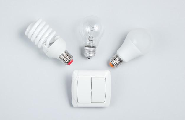 別の電球、スイッチ。ミニマリズムエレクトロコンシューマーコンセプト