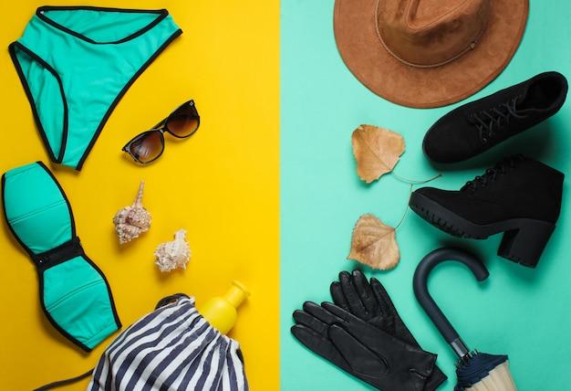 色紙の表面に服とアクセサリーの秋と夏のビーチシーズン。