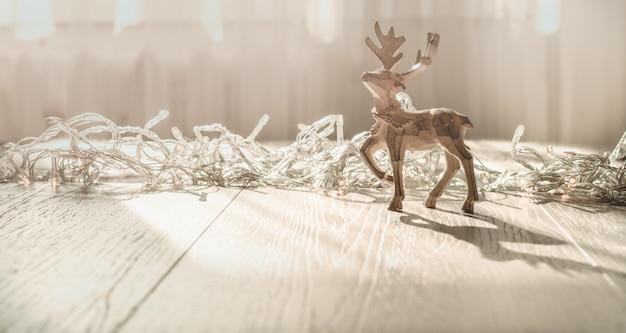 クリスマスの鹿とメリークリスマスカード。