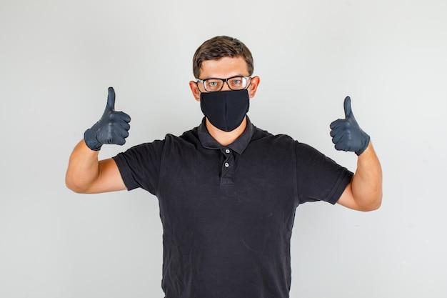 親指を現して感謝している黒のポロシャツの若い医者