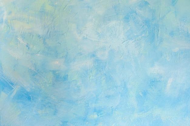 青い斑点のあるセメントの古い壁